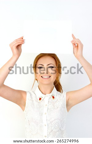 Young woman is holding blank banner - stock photo