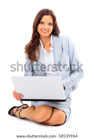 young woman is lying on the floor and working on a laptop - stock photo