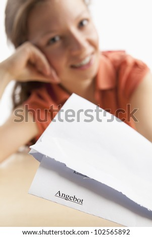 Young woman is pleased with written offer - stock photo