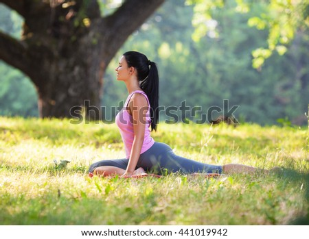 stock photo young woman is practicing yoga outdoors on sunny day she relaxing at the park 441019942