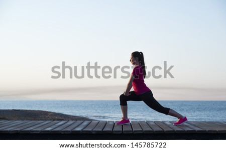 Young woman is running in sunny nature - stock photo