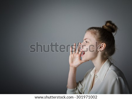 Young woman is screaming at something. Young slim woman. - stock photo