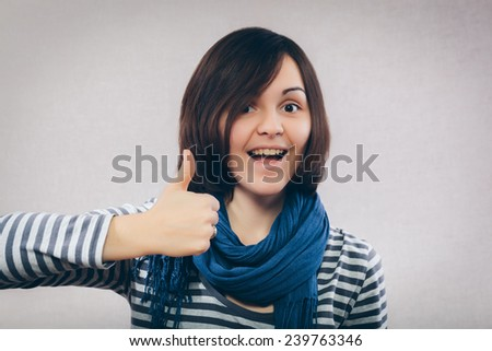 Young woman  is showing thumb up gesture hands - stock photo