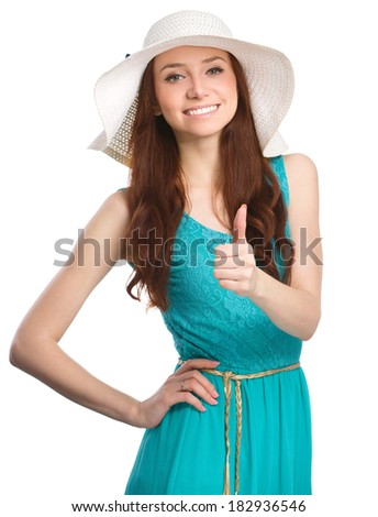 Young woman is showing thumb up gesture, isolated over white - stock photo