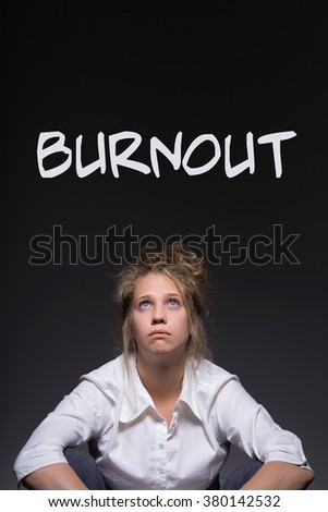 Young woman is tired because of her job  - stock photo