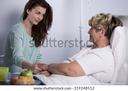 Young woman is visiting her sick relative