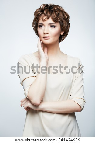 Young woman isolated portrait with arms. Short hair.