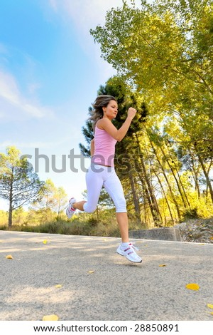 young woman jogging/jumping on road
