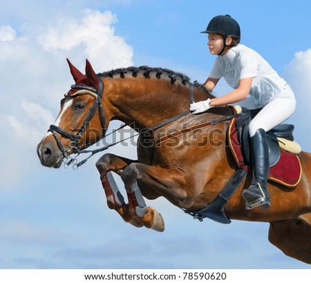 Young woman jumping with bay horse - stock photo