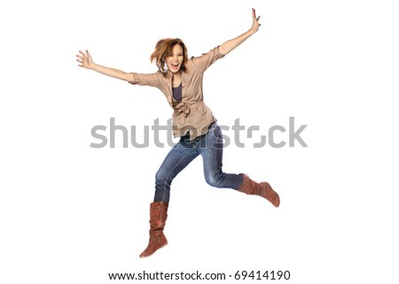 Young woman jumping with joy
