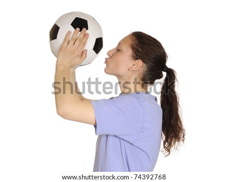 young woman kissing a soccer ball - stock photo