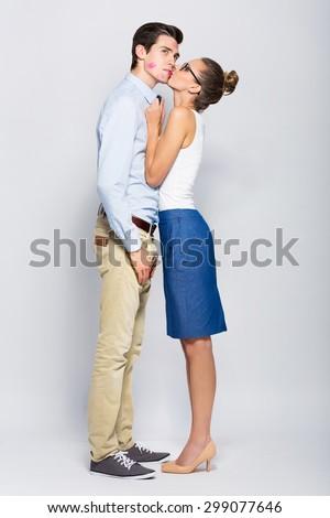 Young woman kissing man  - stock photo