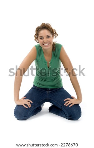 young woman kneeling on the ground