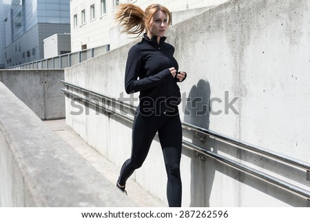 Young woman knows that sport is healthy - stock photo