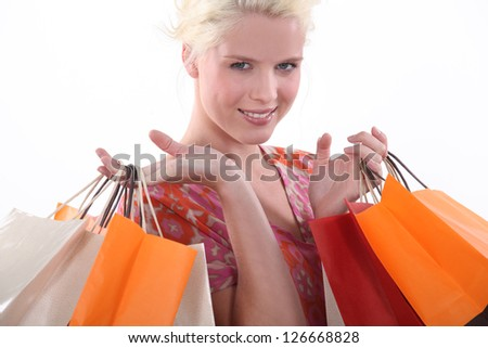 Young woman laden down with store bags