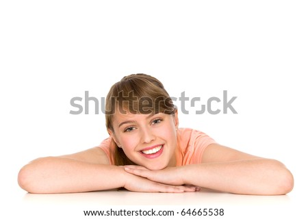 Young woman leaning on a table - stock photo