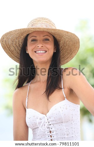 young woman light-dressed, smiling