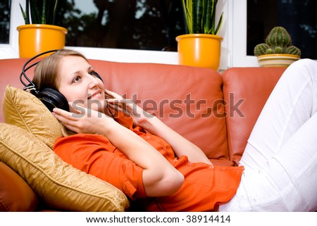 young woman listen to the music with head phones - stock photo