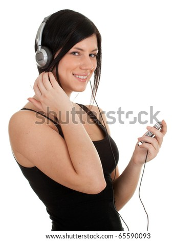 young woman listening music from mp3 player - stock photo