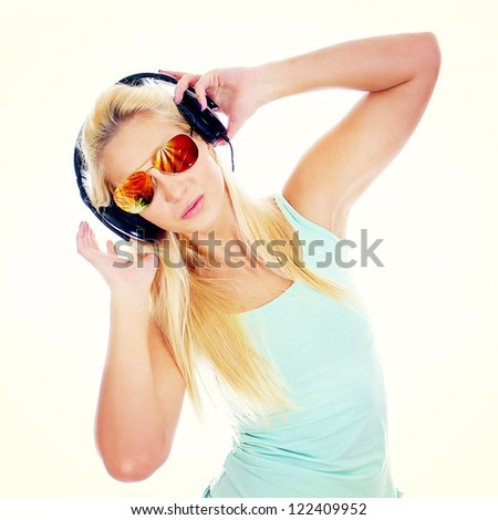 Young woman listening music in headphones.