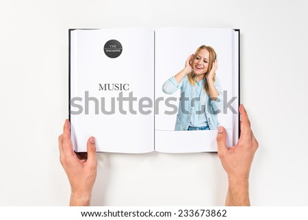 Young woman listening music over white background - stock photo