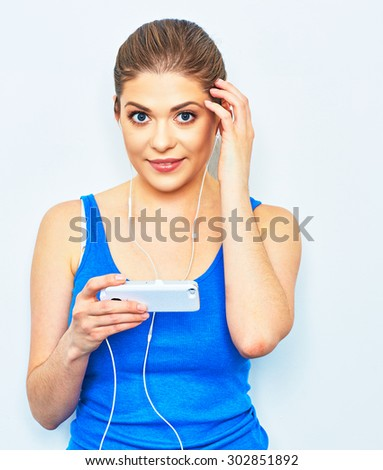Young woman listening music with smartphone. Isolated portrait. - stock photo