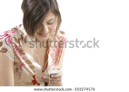Young woman listening to music with her earphones and smiling. - stock photo