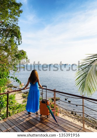 Young woman looking at the sea. - stock photo