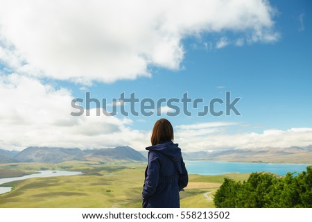 Young Woman looking at view from mt john university observatory, New Zealand
