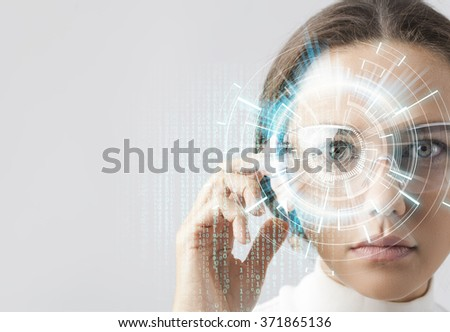 Young woman looking at virtual graphics in futuristic background - stock photo