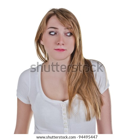 Young woman looking down-left with expression as she is afraid of something - stock photo
