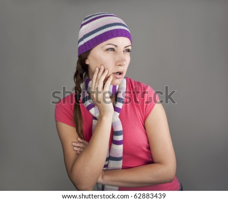 Young woman looking enviously - stock photo