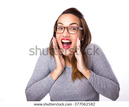 young woman looking excited against white background - stock photo