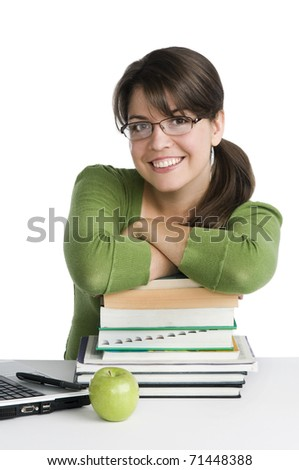 young woman looking like a student/teacher, with laptop, stack of books,green apple - stock photo