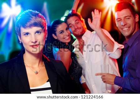 Young woman looking outsider at a party, friends having fun.