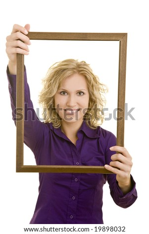 Young woman looking through a frame - stock photo