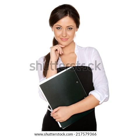 young woman looks like a student holding folder with papers and looking in the camera - stock photo