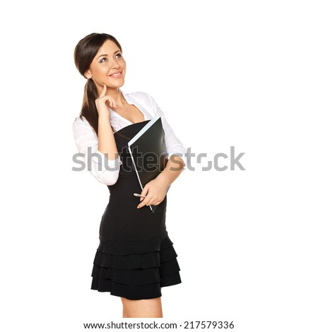 young woman looks like a student holding folder with papers and looking up - stock photo