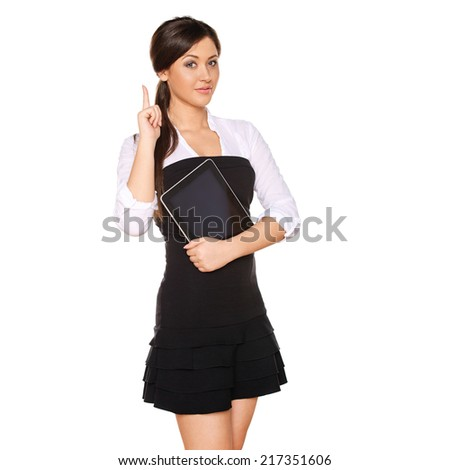 young woman looks like a student holding tablet PC  and  pointing up showing copy space