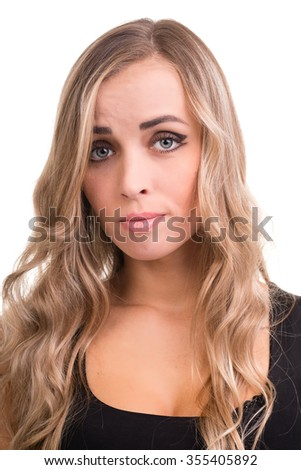 young woman looks skeptical, isolated on white studio shot - stock photo