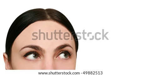 young woman looks up and thinks - stock photo