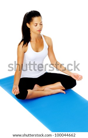 Young woman lotus pose yoga mat. This is part of a series of various yoga poses by this model, isolated on white - stock photo