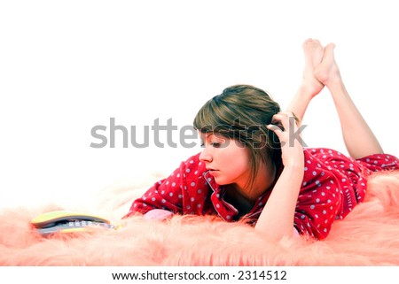 Young woman lying on bad and expecting the phonecall. - stock photo