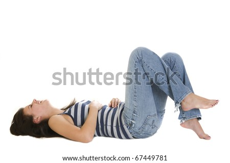 Young woman lying on her back laughing - stock photo