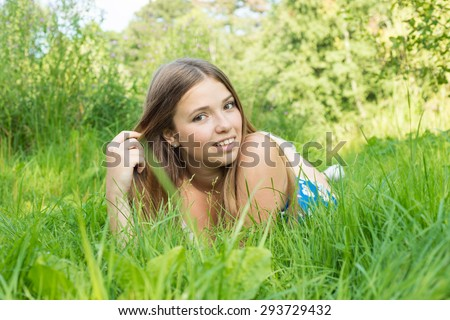 Young woman lying on the grass in summer