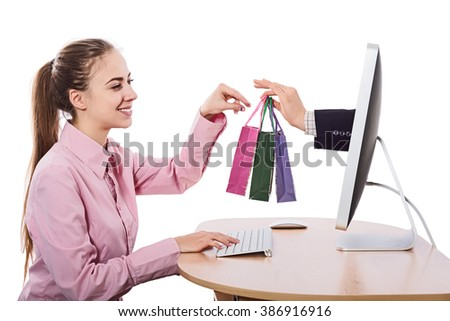 Young Woman makes Order in virtual Shop at Computer and gets instant Delivery smiling happy Face smart casual Business Clothing white Background - stock photo