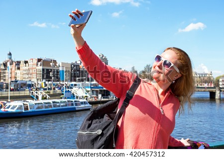 Young woman making a selfie in Amsterdam the Netherlands - stock photo