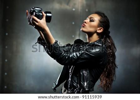 Young woman making fashion self portrait. - stock photo