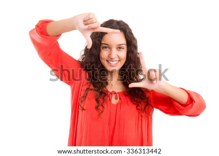 Young woman making framing key gesture - isolated over white - stock photo