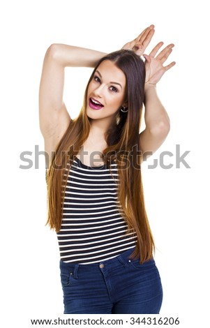 Young woman making funny face. - stock photo